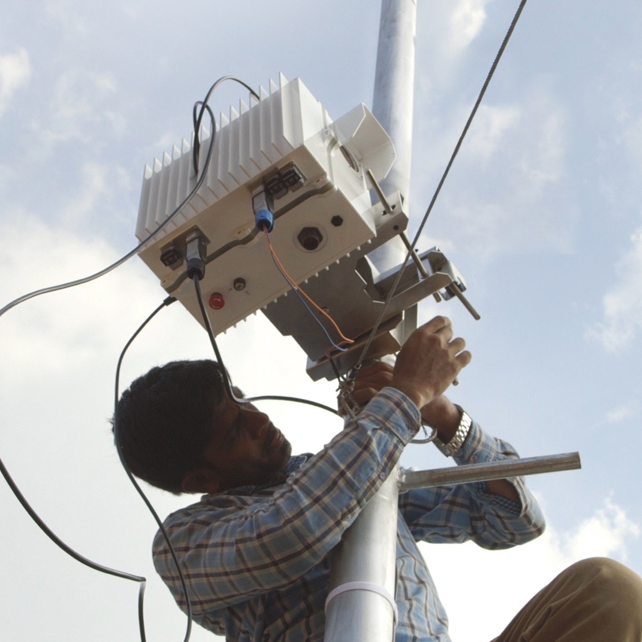 Man works on FSOC installation in India.