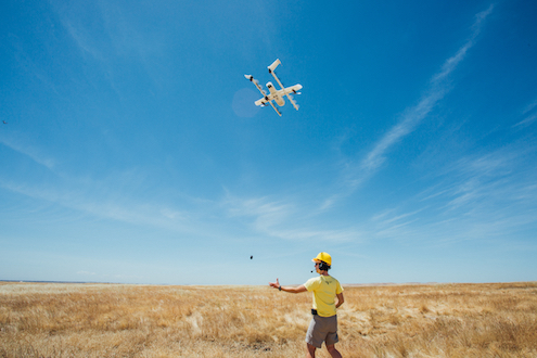 X employee in Australia prepares drone for flight.
